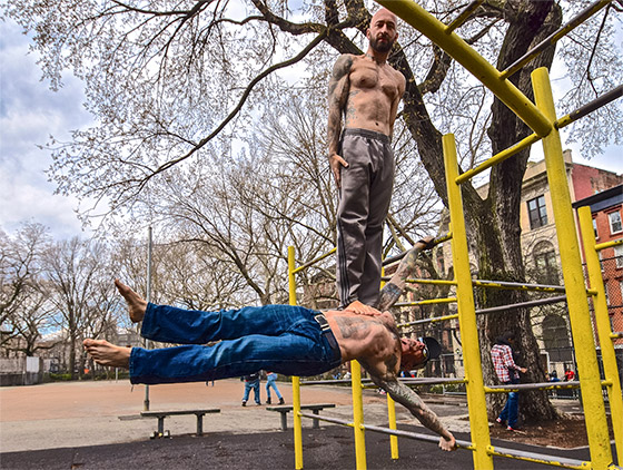 Danny Kavadlo and Al Kavadlo human flag, strength training
